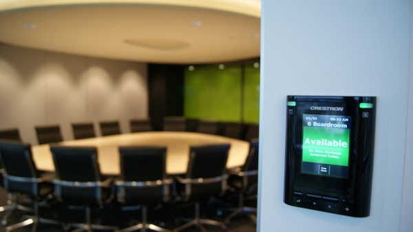 Available sign on black Wall mounted Crestron boardroom booking system