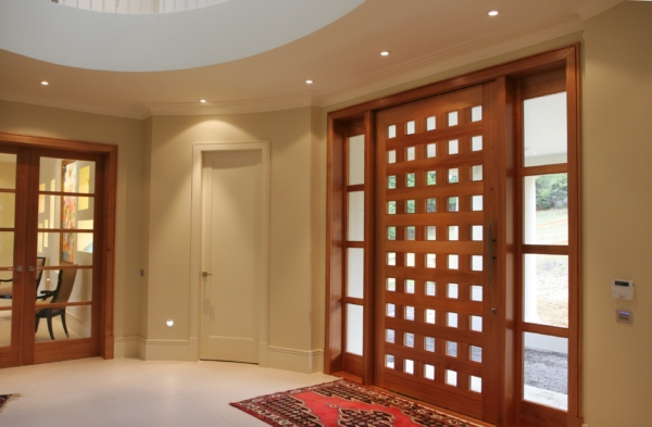 Beautiful custom made wooden designer door at house entrance