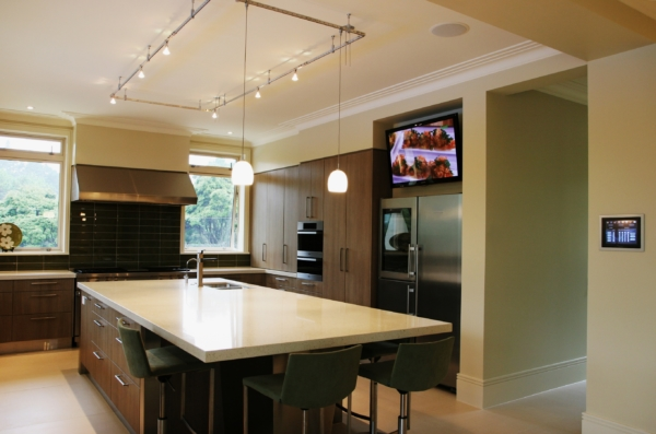 Luxury kitchen with wall mounted TV