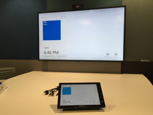 Wall mounted TV with Crestron touch pad controller at Fonterra Experience Centre
