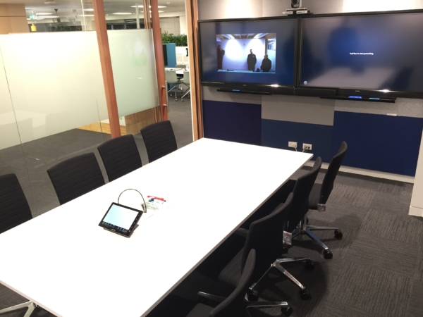 "Meeting room at Fonterra with two 60"" Screen TVs and touchscreen panel control"