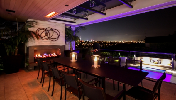 Open dinning area decorated with beautiful lights & city sky view