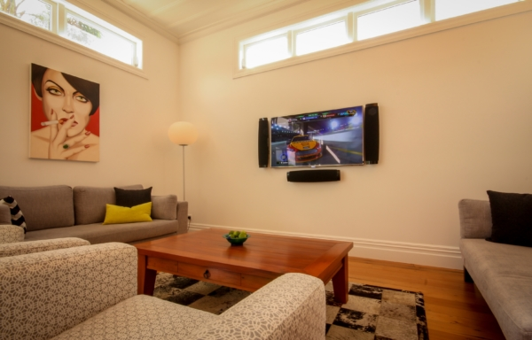 Lounge featuring a Samsung 8000 Series LED TV and on-wall slim-line speakers