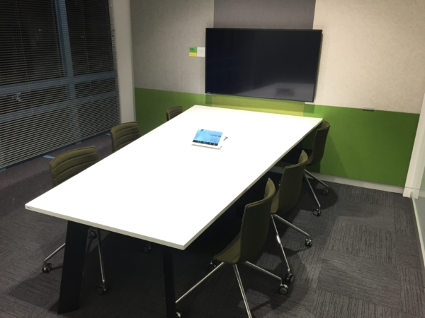 "Meeting room at Fonterra showing a 47"" wall mounted TV and touchscreen control panel"