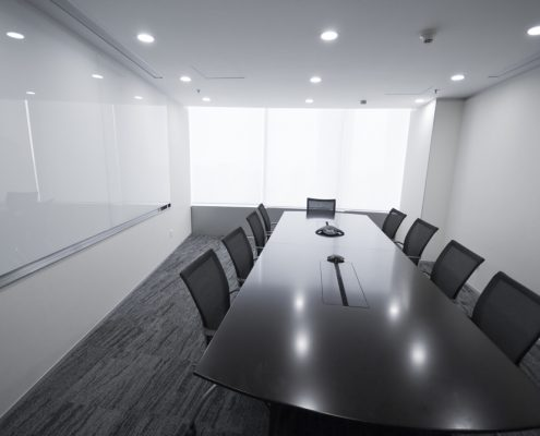 Conference room with wall mounted big white board