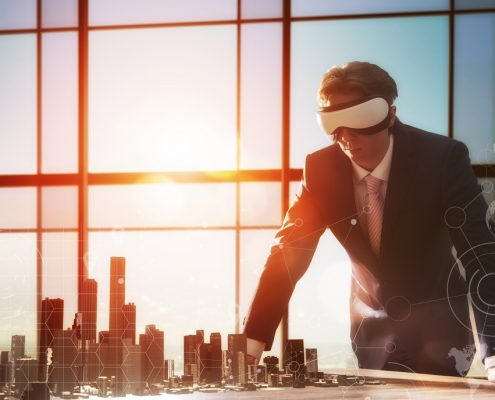 Businessman using virtual reality for project design