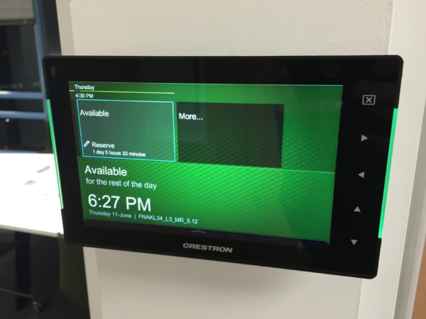 Crestron touch panel showing room availability