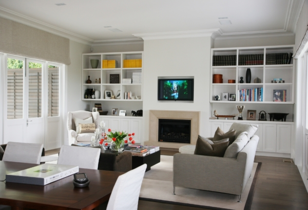 White color living room with wall fitted TV