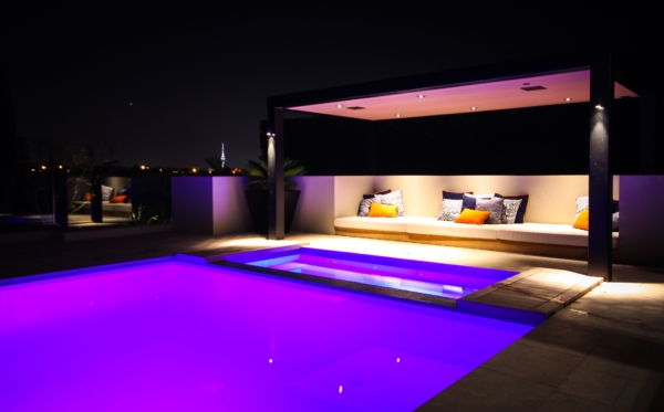 Outdoor entertaining pool area with speakers and lighting control