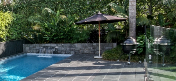 Swimming pool with waterfall and hidden speakers