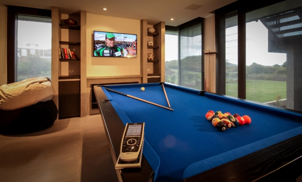 "40"" HD TV with celling speakers in pool room"