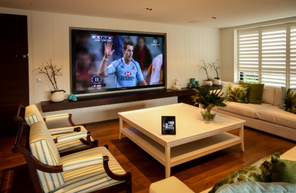 Modern guest house home theatre with simple touchscreen control