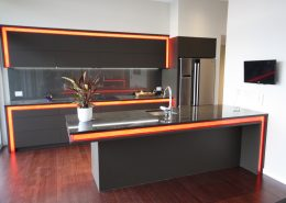Kitchen with automated feature lighting and TV