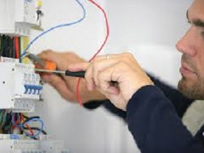 Electrician working on house electric system