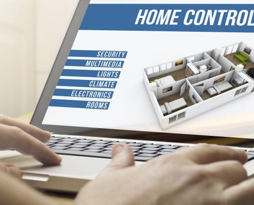 Person viewing home automation design on laptop